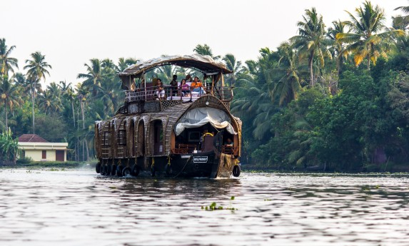 Houseboat gliding across the backwaters